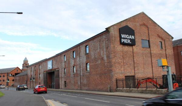 Wigan signs
